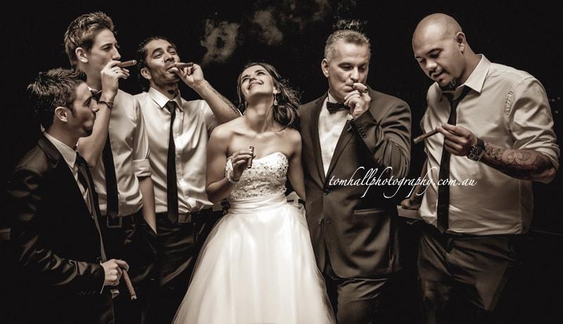 groomsmen-and-bride-smoking-a-cigar